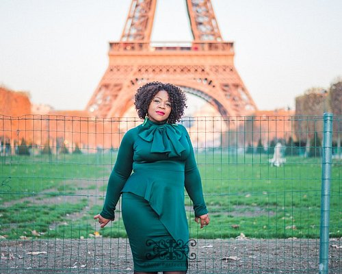 Woman in front of the Eiffel Tower in Paris, France.