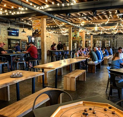 Our tap room is great for large groups and families alike. It is fully equipped with board games, ping pong tables, bubble hockey, a stage for live entertainment and a projector for sports games.