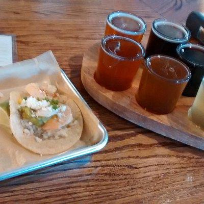 Gambas shrimp taco and a tasting flight of six.