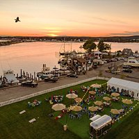 Sunset Landing, waterside Niantic River is an outdoor event venue, featuring both public and private events. Sunset Landing hosts public events when it is not privately rented, and features music, firepits, corn hole and a diverse menu offering lobster rolls, vegetarian options and bbq,complete with full bar, brought to you by Festive Catering.