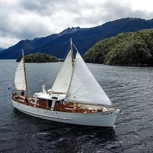 """Motor Yacht """"Faith"""" in all of her sailing glory, exploring the South Fiord of Lake Te Anau, Fiordland, New Zealand."""