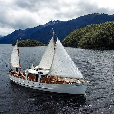 "Motor Yacht ""Faith"" in all of her sailing glory, exploring the South Fiord of Lake Te Anau, Fiordland, New Zealand."