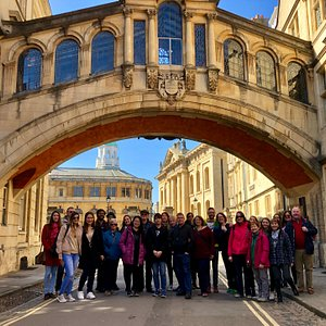 """Our Free Tour group on a sunny Sunday morning in March. We are standing under Hertford Bridge - famously known as Oxford's """"Bridge of Sighs""""."""