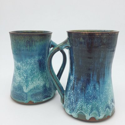 Handmade coffee mugs by Adam Mackay.