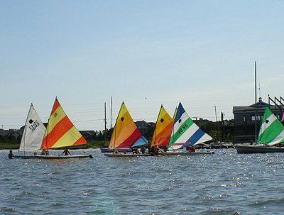 The sailing school fleet heads out onto the bay. Private lessons are also available.