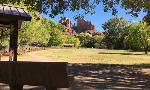 Take in the view of Cathedral Rock from the Day Use Area at Crescent Moon. Picnic tables, trails, restrooms, and sitting benches in the sun and shade are provided.