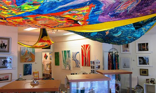 Three handmade silk jib sails, created for the 'Encounter 2002' celebrations in Kingscote, are on display on the ceiling of the KI Gallery in Murray St. The sails were part of an event that marked 200 years since Matthew Flinders met Nicolas Baudin at Encounter Bay while they were both busily mapping the 'unknown coast' of Terra Australis. The three large silk sails were created, incorporating individual artworks of the island's flora and fauna from KI children in years 3 and 4.