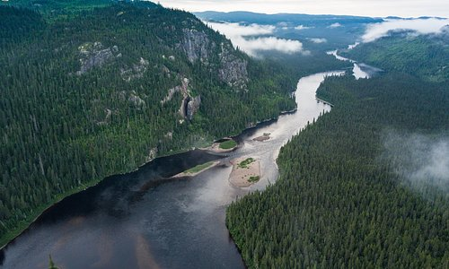 The 'Valley of the Eagles'—where the rapids subside for a few kilometres—gentle current carries us by towering cliffs