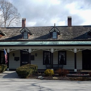 A beautiful old homestead located in a lovely village green.  Love the gingerbread style trim!
