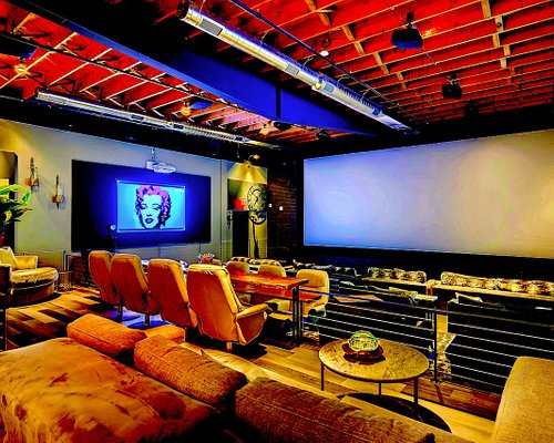 Studio One Theaters New York Penthouse Auditorium. View from the library section. One of 7  beautiful cosmopolitan Penthouse Auditoriums all showing first run movies with 4K Laser Projectors 128 Channel Dolby ATMOS 360 sound in theater full farm to table restaurant and bar service.