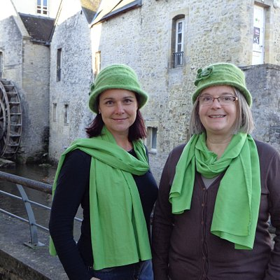 Christèle and Marie-Noëlle in front of the water wheel