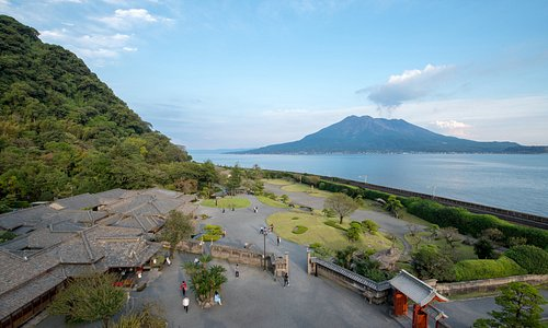 The house and gardens at Sengan-en overlooking Kinko Bay and active volcano Sakurajima