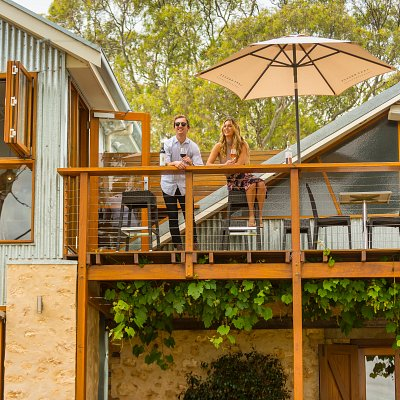 enjoy an afternoon on the deck at Lake Breeze, overlooking the stunning vineyard