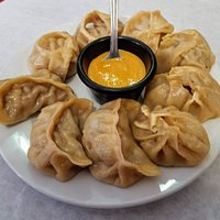 Mixed Momo appetizer (71) $12.95  Three dumplings (Momo) of vegetable, chicken and lamb. We asked for their homemade hot sauce(yummy). It was better than the one that is shown. Sorry forgot to take a picture of the hot sauce...I was busy eating it!