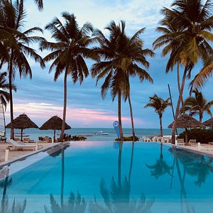 The rooms and spectacular view of the pool and beach.