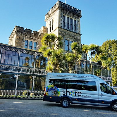 One of our tour vehicles outside Larnach Castle