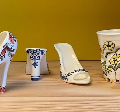 Local artist Trudy Otterspeer decorated these wonderful shoes and crumpled cups.