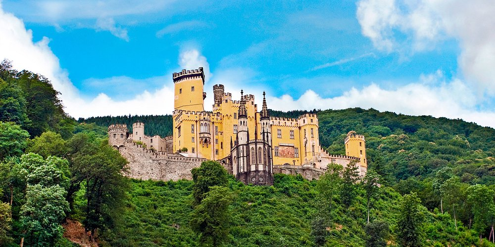 Resting high above the river Rhine, witness the medieval Stolzenfels Castle as we drift along the German shoreline.