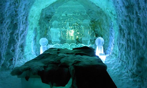 The Kingdom of Permafrost. Beautiful Ice Bed with a bear skin rug.