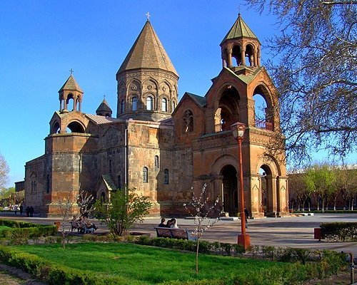"""Echmiadzin, which means the """"The Descent of the Only Begotten Son"""", is an ancient capital of Armenia. According to legend, Jesus Christ descended from heaven and indicated the place for a church to be built. Holy Echmiadzin Cathedral was erected at that site in the 4th century (301-303), at the dawn of the Christian conversion of the country by King Trdat III and Saint Gregory the Illuminatior. Now it's a religious center of Armenia, where thousands of tourists come every year."""