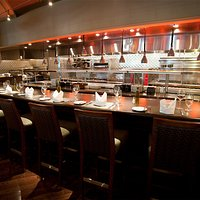 Dine at our Chefs table overlooking the open kitchen concept.