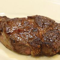 Tuesday through Thursday we offer our 16 oz hand-carved Ribeye for $29 that comes topped with Sautéed Onions served with a side salad or soup and a dish.