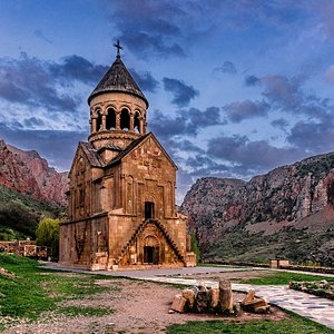 Century of Foundation: XIII Date of Foundation: 1221 Region: Vayots Dzor Location: Amaghu village The Noravank Monastery is situated deep in the Noravank canyon, and from a distance appears to be perched high on the flat surface of a rock, nestled into a majestic mountain. The main church of St. Karapet was built in 1221-1227. It is the regional religious center founded by Bishop Hovhannes in 1339. The relief sculpture over the doors depicts Christ flanked by Peter and Paul. According to legend,