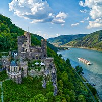 Glide down the river for a breathtaking view of the Rheinstein Castle. Ready to explore? Click the link in our intro!