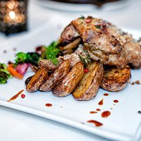 Baby Chicken Char grilled Baby chicken, oven roasted with herbs and breadcrumbs, oyster mushrooms and spicy chicken jus
