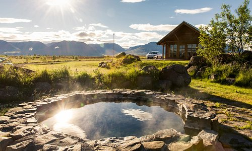From the hot pot in the middle of our cottage site, you can enjoy the midnight sun or the northern lights. Open 24/7, it is the perfect place to end a long day of exploring North Iceland.