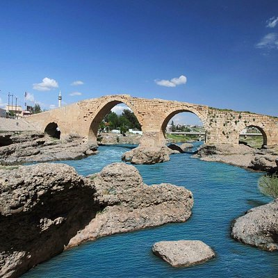 """Delal, Zakho Bridge, Pira Delal or Pirdí Delal (""""The Bridge Delal"""" in Kurdish), is an ancient bridge over the Khabur river in the town of Zakho, in the Kurdistan Region of Iraq. The bridge is about 115 metres long and 16 metres high."""
