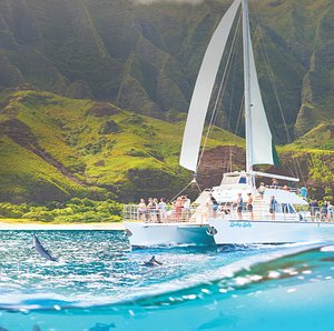Our 60ft Luxury Catamaran is equipt with a waterslide, swim step and cocktail bar!