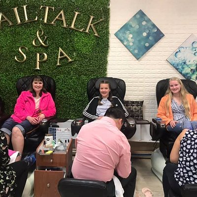 A family's having fun at Nail Talk and Spa.