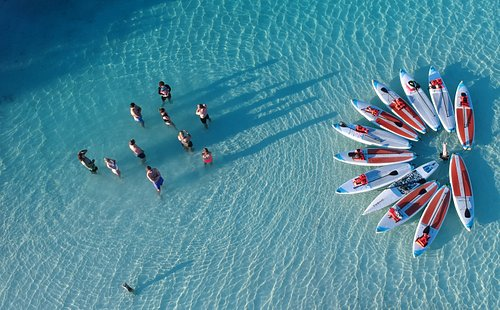 Group SUP activity on turquoise waters.