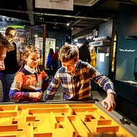 The MAD Museum - brother and sister using maze table