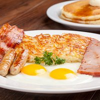 Bigger Better Breakfast: 2 Bacon, 2 Sausage, 2 Eggs, Ham, Hash browns, and Toast OR 2 Hotcakes.