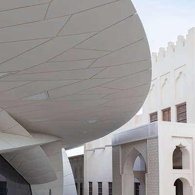 View of the Sheikh Abdullah bin Jassim Al Thani's Old Palace together with corner view of the the National Museum of Qatar designed by Atelier Jean Nouvel Photo credit: Iwan Baan