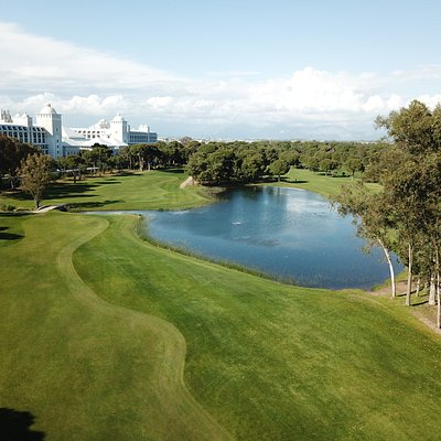 on the River course (the ball is not hit over the lake, but one fairway is to the right of the lake, the other to the left. Hotel Titanic in the background.