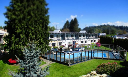 Beautiful heated, outdoor pool surrounded by mature well-maintained landscaping.