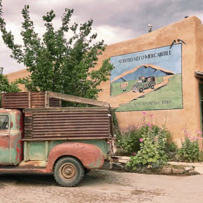 Apparently this old truck belongs to the shop and is one of the most painted trucks in New Mexico. There is an old wagon and a very old log house in the garden too. Worth a visit!