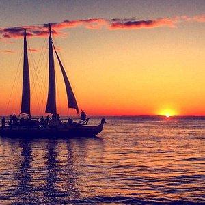 Mon Tiki Largo catamaran glides out for sunset