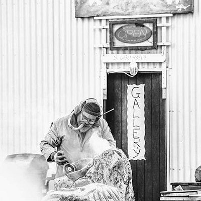 Liston making sculptures outside his gallery