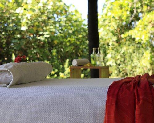 A full body massage in front of Playa Las Lajas, next to Las Lajas Beach Resort.