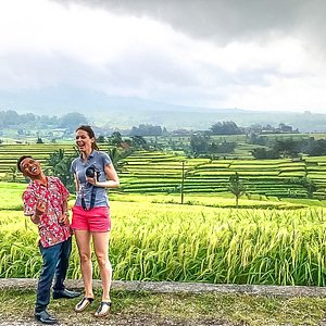 """Jatiluwih Rice Terraced the weather support us to capture the beauty of the rice field, in the begining I am ( Gede ) helping to take photo of the them, I saw the picture so beautiful ,  and I asked would you like to take  my photo please, and he said """" you said the rice field so beautiful or my wife so beautiful? and I said your wife more beautiful than rice trerraced , and every one is laughing ..."""