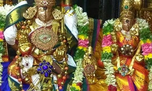"""Meenakshi Amman Temple is dedicated to Parvati, known as Meenakshi. The temple attracts 15,000 visitors a day, around 25,000 on Fridays. There are an estimated 33,000 sculptures in the temple. It was on the list of top 30 nominees for the """"New Seven Wonders of the World"""". The annual 10-day Meenakshi Tirukalyanam festival, celebrated during April and May, attracts 1 million visitors."""