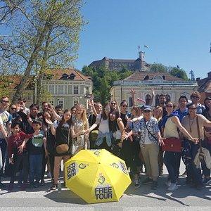 Happy free tour group in Ljubljana's Congress Square