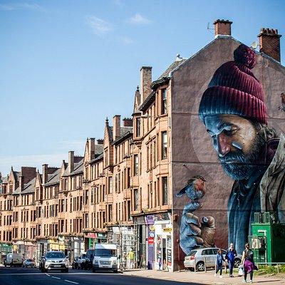 """""""St Mungo Mural"""" realizzato dall'artista di strada australiano Sam Bates, alias SMUG. Mungo è il santo patrono di Glasgow, nato nel VI secolo."""