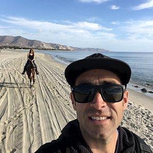 Horseback riding along the shore