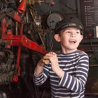 Boy pulling the whistle of the Tivvy Bumper steam engine