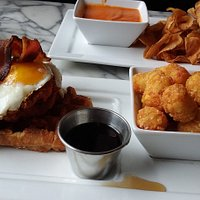 They call this a waffle.....with hot southern chicken, bacon, eggs, maple syrup & duck fat tater tots